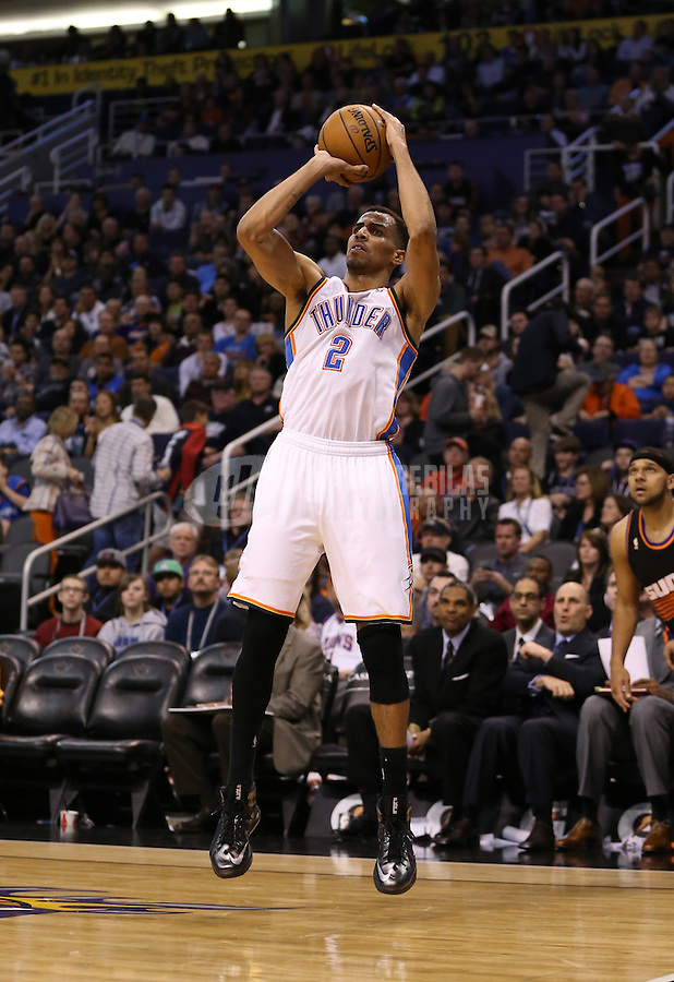Feb. 10, 2013; Phoenix, AZ, USA: Oklahoma City Thunder shooting guard Thabo Sefolosha against the Phoenix Suns at the US Airways Center. Mandatory Credit: Mark J. Rebilas-