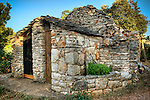 A farm building near the Croatian tavern Konoba Humac on Hvar Island...Konoba Humac, owned by the Franicevic family,  is a restaurant which combines traditional Croatian tavern food with an exotic setting in the abandoned agricultural village of Humac on a mountain peak on the Island of Hvar, Croatia. All the food is organic and picked by its diners from the fields nearby. Konoba Humac is an entrepreneurial combination of traditional dining and ecotourism trends. Photo copyright 2007 www.lawrencelucier.com