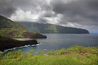 Landscape on the North West coast, near Nahoe, on the island of Hiva Oa, in the Marquesas Islands, French Polynesia. This area consists of tropical dry forests and a small rocky beach. Picture by Manuel Cohen