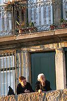 two old ladies talking cais da ribeira porto portugal