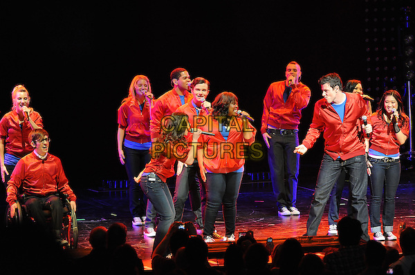 CAST.'Glee' performs at The Gibson Amphitheater, Universal City, California, USA..May 20th, 2010.stage concert live gig performance singing dancing music full length jeans denim red jacket Dianna Agron Chris Colfer Mark Salling Kevin McHale Jenna Ushkowitz Lea Michele Cory Monteith Amber Riley.CAP/RKE/DVS.©DVS/RockinExposures/Capital Pictures.