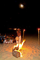 Evening beach party with bonfire and music