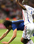 09 July 2006: Patrick Vieira (FRA) (4) keeps his hands away as Luca Toni (ITA) (left) tumbles to the turf. Italy tied France 1-1 in overtime at the Olympiastadion in Berlin, Germany in match 64, the championship game, of the 2006 FIFA World Cup Finals. Italy won the World Cup by defeating France 5-3 on penalty kicks.