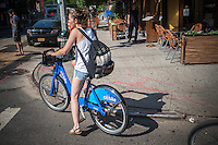 "Bicycle enthusiast uses Citibike in the East Village neighborhood of New York on Saturday, June 1, 2013. 6000 bikes in over 300 stations have been placed so far for the roll out of the program. Cyclists purchased one-year passes for $95 which gives them unlimited 45 minute rides to get from point ""A"" to point ""B"". Daily and hourly passes will soon be available.  (© Richard B. Levine)"