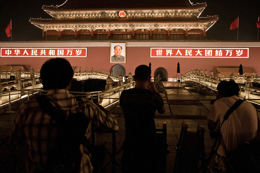 Chinese tourists are taking picture of the Tiananmen gate (the Old Palace) with the portrait of Mao Zedong, during celebration of the CPC 90 Years Anniversary 2011.