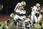 Torrance, CA 11/05/10 - Okuoma Idah (Peninsula #24), Mickey O'crowley (Peninsula #53) and unknown Peninsula player in action during the Peninsula vs West varsity football game played at West Torrance high school.