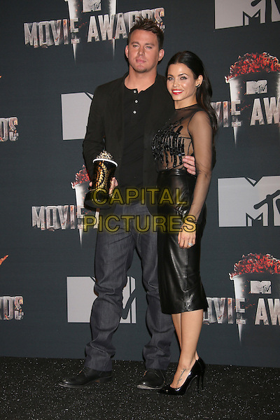 LOS ANGELES, CA - APRIL 13: Channing Tatum and Jenna Dewan-Tatum in the press room at the 2014 MTV Movie Awards at Nokia Theatre L.A. Live on April 13, 2014 in Los Angeles, California. <br /> CAP/MPI/JO<br /> &copy;Janice Ogata/MPI/Capital Pictures