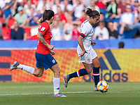 PARIS,  - JUNE 16: Carli Lloyd #10 carries the ball forward during a game between Chile and USWNT at Parc des Princes on June 16, 2019 in Paris, France.