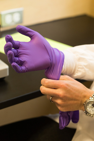 May 7, 2014. Durham, North Carolina.<br />  A student puts on protective gloves before conducting a lab assignment in a GYN class. <br />  The Duke University School of Medicine Physician Assistant Program is one of the top programs in the country for the training of physician's assistants. PA's are in high demand, and are taking over many of the tasks traditionally done by MD's, so the competition for the program is intense. In the most recent class, there were only 88 spots for a application pool of 1600.