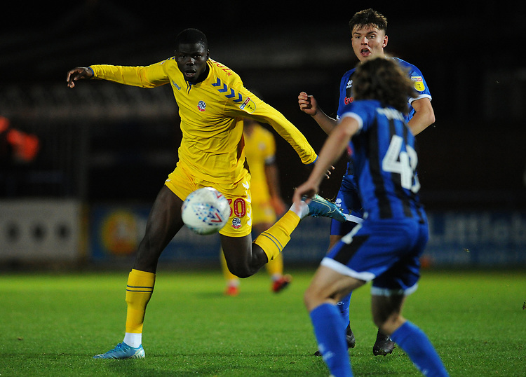 Bolton Wanderers' Yoan Zouma vies for possession with Rochdale's Aaron Morley<br /> <br /> Photographer Kevin Barnes/CameraSport<br /> <br /> EFL Leasing.com Trophy - Northern Section - Group F - Rochdale v Bolton Wanderers - Tuesday 1st October 2019  - University of Bolton Stadium - Bolton<br />  <br /> World Copyright © 2018 CameraSport. All rights reserved. 43 Linden Ave. Countesthorpe. Leicester. England. LE8 5PG - Tel: +44 (0) 116 277 4147 - admin@camerasport.com - www.camerasport.com
