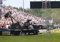 Mar 14, 2015; Gainesville, FL, USA; The  dragster of NHRA top fuel driver Larry Dixon is taken back to the pits on a flat bed tow truck after his car broke in half and crashed during qualifying for the Gatornationals at Auto Plus Raceway at Gainesville. Dixon walked away from the incident. Mandatory Credit: Mark J. Rebilas-