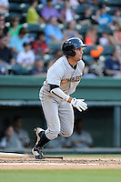 Second baseman Vicente Conde (4) of the Charleston RiverDogs bats in a game against the Greenville Drive on Monday, June 29, 2015, at Fluor Field at the West End in Greenville, South Carolina. Greenville won, 4-2. (Tom Priddy/Four Seam Images)