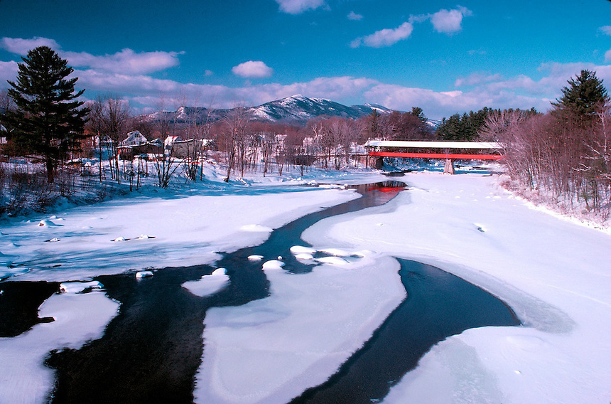 A winter's day at Conway, New Hampshire. Covered bridge crosses the Saco River, with Moat Mountain in the background. Photograph by Peter E. Randall.