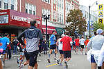 Denis Brogniart (middle), French host of French reality television show Survivor, is seen running at mile marker eight in the Chicago Marathon on North Broadway Avenue on the north side in Chicago, Illinois on October 11, 2009.