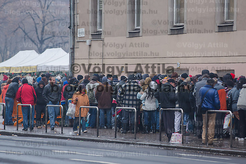 People queue for free food distributed by Krishna charity activists in Budapest, Hungary on December 25, 2012. ATTILA VOLGYI