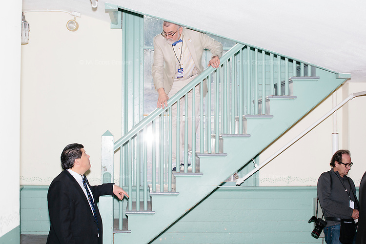 A campaign volunteer controls access to the balcony before real estate mogul and Republican presidential candidate Donald Trump speaks at a rally at Exeter Town Hall in Exeter, New Hampshire, on Thurs., Feb. 4, 2016.