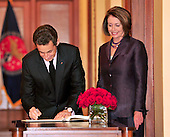 Washington, D.C. - March 30, 2010 -- President Nicolas Sarkozy of France signs the guest book as the Speaker of the United States House of Representatives Nancy Pelosi (Democrat of California) looks on as he arrives for a visit in the U.S. Capitol on Tuesday, March 30, 2010..Credit: Ron Sachs / CNPWashington, D.C. - March 30, 2010 -- President Nicolas Sarkozy of France visits the Speaker of the United States House of Representatives Nancy Pelosi (Democrat of California) in the U.S. Capitol on Tuesday, March 30, 2010..Credit: Ron Sachs / CNP