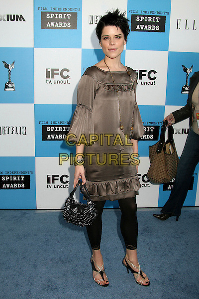 NEVE CAMPBELL.2007 Film Independent's Spirit Awards at the Santa Monica Pier, Santa Monica, California, USA,.24 February 2007..full length short spiky hair brown silk satin tunic black leggings .CAP/ADM/BP.©Byron Purvis/AdMedia/Capital Pictures.