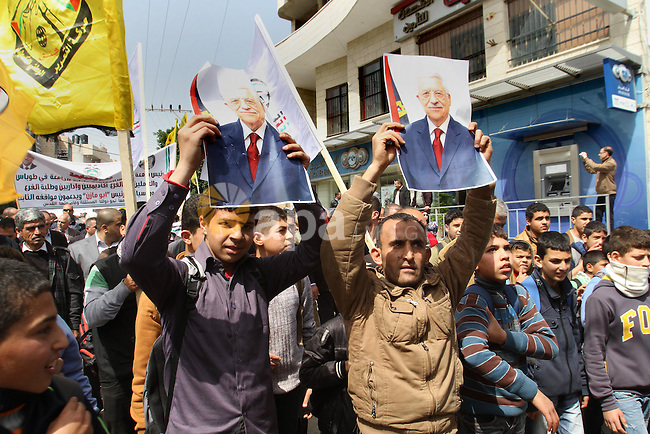 Palestinian Fatah supporters hold placards showing pictures of President Mahmoud Abbas during a rally in support of Abbas in the West Bank village of Tubas near Jenin March 16, 2014. With pessimism growing over future of Middle East peace talks, U.S. President Barack Obama will meet Abbas in Washington on Monday to try to break stalemate. Photo by Nedal Eshtayah