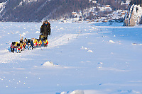 Gerry Wilomitzer on the Yukon River two miles after leaving the village checkpoint of Ruby at sunset during the 2010 Iditarod