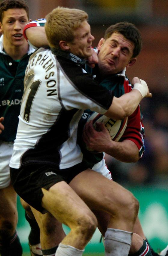 Photo: Richard Lane..Leicester Tiger v Newcastle Falcons. Zurich Premiership. 19/02/2005..Michael Stephenson tackles John Rawson.