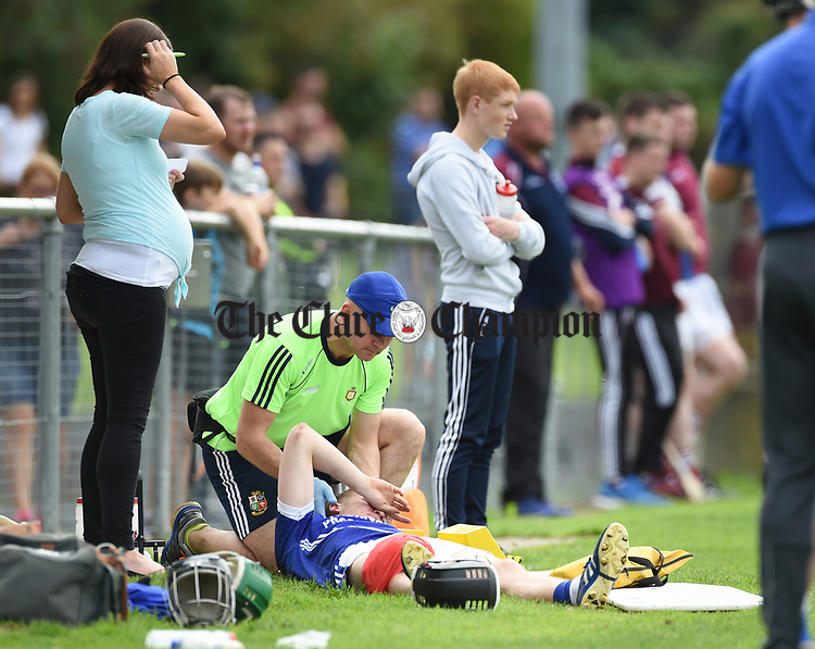 David Collins of Cratloe is treated after an injury by physio Ger Crotty on the sideline during their round three senior championship game against St Joseph's in Sixmilebridge. Photograph by John Kelly