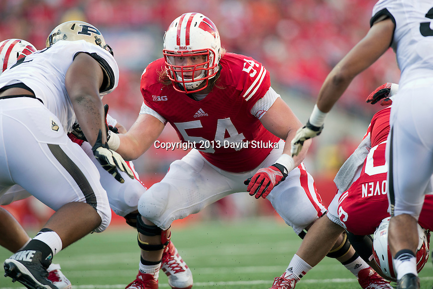 Wisconsin Badgers offensive linemanKyle Costigan (54) blocks during an NCAA Big Ten Conference football game against the Purdue Boilermakers on Saturday, September 21, 2013, in Madison, Wis. The Badgers won 41-10. (Photo by David Stluka)
