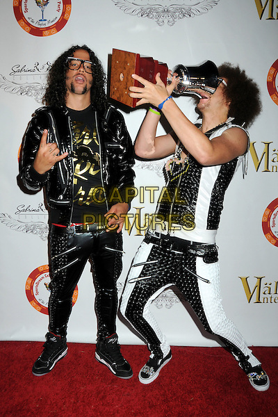 LMFAO - Sky Blu (Skyler Gordy) & Redfoo (Stefan Gordy). 4th Annual Sports Dream Celebrity Poker and Pool Party Celebrating the 2010 ESPY Awards held at the Playboy Mansion, Beverly Hills, California, USA..July 12th, 2010.Laughing My Fat Ass Off electro-hop group full length white black white leather trousers jacket gold necklace drink drinking profile glasses trophy award mouth open funny arms in air .CAP/ADM/BP.©Byron Purvis/AdMedia/Capital Pictures.