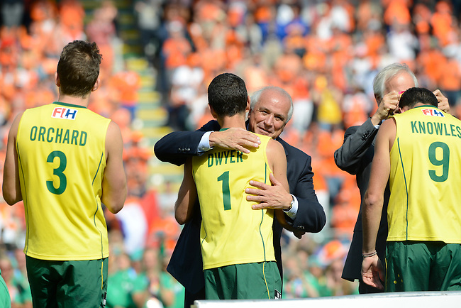 The Hague, Netherlands, June 15: The Australian team enters the stage for the prize giving ceremony after beating the team of The Netherlands 6-1 (2-1) in the final on June 15, 2014 during the World Cup 2014 at Kyocera Stadium in The Hague, Netherlands. (Photo by Dirk Markgraf / www.265-images.com) *** Local caption *** Simon Orchard #3 of Australia, Jamie Dwyer #1 of Australia, Mark Knowles #9 of Australia