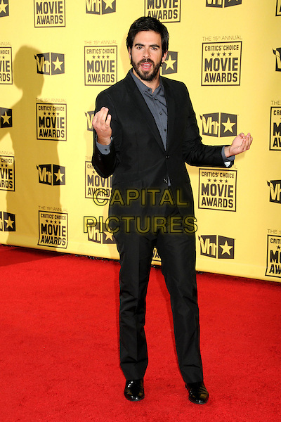 ELI ROTH .15th Annual Critics' Choice Movie Awards - Arrivals held at the Hollywood Palladium, Hollywood, California, USA, 15th January 2010..full length gray grey suit beard facial hair hands funny suit black shirt .CAP/ADM/BP.©Byron Purvis/Admedia/Capital Pictures