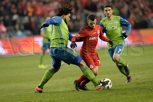 10.12.206. Toronto, ONT, Canada. MLS Football League Cup. Roman Torres (29) of Seattle Sounders tackles Sebastian Giovinco (10) of Toronto FC during the first half of the MLS Cup Final game between Toronto FC and Seattle Sounders on December 10, 2016, at BMO Field in Toronto, ON, Canada.