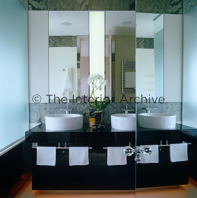 A double washbasin is a feature of this sleek, modern and monochrome bathroom