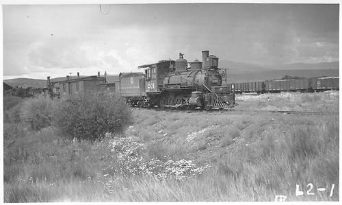 Engine #201 with work train near Gunnison.<br /> D&amp;RGW  Gunnison, CO  Taken by Rogers, Donald E. A. - 8/11/1935