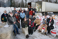 Saturday February 20, 2010.   Volunteers help load Iditarod airforce plane with musher's food bags and supplies for delivery to the Rainy Pass checkpoint at Willow Airport.