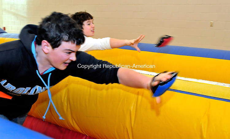 MIDDLEBURY, CT-10 JANUARY 2009-011010JS06-FOR COUNTRY LIFE-Robert Patterson, 14, left, and Wyatt Clark, 14, right, both of Woodbury, battle each other on the Bungee Run Sunday during the annual Dorcus Fair at Westover School in Middlebury. The event is a fundraiser sponsored by the Junior Class. <br /> Jim Shannon Republican-American
