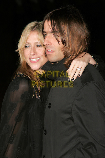 "NICOLE APPLETON & LIAM GALLAGHER.The UK Film Premiere of director Martin Scorsese's ""Shine A Light"" documentary featuring The Rolling Stones, held at Odeon cinema, Leicester Square, London, England..April 2nd, 2008.half length sheer arm over shoulder nail varnish polish black married husband silver ring wife .CAP/AH.©Adam Houghton/Capital Pictures."