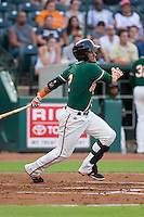 Rony Cabrera (2) of the Greensboro Grasshoppers follows through on his swing against the Greenville Drive at NewBridge Bank Park on August 17, 2015 in Greensboro, North Carolina.  The Drive defeated the Grasshoppers 5-4 in 13 innings.  (Brian Westerholt/Four Seam Images)