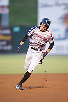 Jameson Fisher (11) of the Kannapolis Intimidators legs out a triple against the Hickory Crawdads in game two of a double-header at Kannapolis Intimidators Stadium on May 19, 2017 in Kannapolis, North Carolina.  The Intimidators defeated the Crawdads 9-1.  (Brian Westerholt/Four Seam Images)