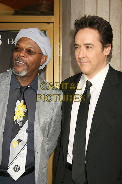 "SAMUEL L. JACKSON & JOHN CUSACK.""1408"" World Premiere held at the Mann National Theater, Westwood, California, USA..June 12th, 2007.half length black suit jacket tie grey gray hat tinted glasses goatee facial hair floral print tie sunglasses shades silver .CAP/ADM/RE.©Russ Elliot/AdMedia/Capital Pictures"