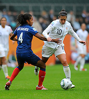 Carli Lloyd (r) of team USA and Laura Georges of team France during the FIFA Women's World Cup at the FIFA Stadium in Moenchengladbach, Germany on July 13th, 2011.