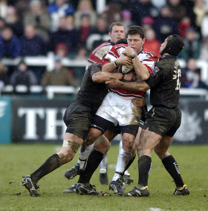 Photo. Jed Wee..Newcastle Falcons v Gloucester, Zurich Premiership, 27/02/2005..Gloucester's Henry Paul is tackled.