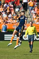 Houston Dynamo midfielder Stuart Holden (22) and Los Angeles Galaxy midfielder Dema Kovalenko (8) go up for the header. Houston Dynamo tied Los Angeles Galaxy 0-0 at Robertson Stadium in Houston, TX on October 18, 2009.