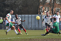 Jon-Paul Pittman of Grimsby Town is denied by Grant Smith of Bognor Regis Town during the FA Trophy Semi Final first leg match between Bognor Regis and Grimsby Town at Nyewood Lane, Bognor Regis, England on 12 March 2016. Photo by Paul Paxford/PRiME Media Images.