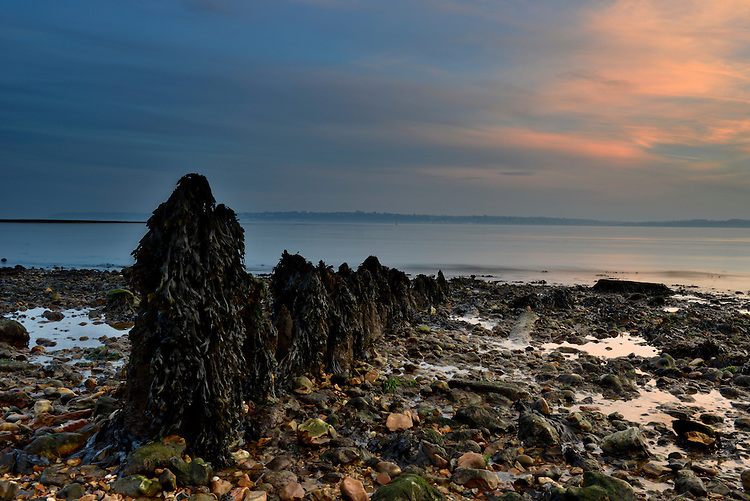 Sunset and incoming tise at Lepe Country Park on the south coast in Hampshire