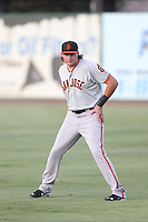 Ryder Jones (9) of the San Jose Giants warms up before a game against the Inland Empire 66ers at San Manuel Stadium on August 26, 2015 in San Bernardino, California. San Jose defeated Inland Empire, 8-1. (Larry Goren/Four Seam Images)