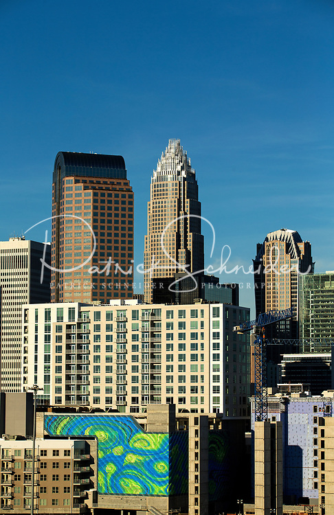 Skyline photography of the Charlotte NC downtown skyline. Photo, taken from the South side of Charlotte, is part on a regularly updated collection of Charlotte skyline imagery. Image shows the Duke Energy headquarters tower (far left) and the Bank of America tower (center) as well as other key structures in the Charlotte NC skyline.<br /> <br /> Charlotte Photographer - PatrickSchneiderPhoto.com<br /> <br /> Charlotte Photographer - PatrickSchneiderPhoto.com