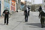 Palestinian security officers take position during a raid against Hamas gunmen in the West Bank town of Qalqiliya, Thursday, June 4, 2009. Three Hamas fugitives in Qalqiliya have opened fire on Palestinian police, killing one of the officers encircling their underground hiding place. Thursday's gunbattle comes as the government is intensifying its crackdown on Islamic militants in the West Bank. Photo/APAimages/Nedal Shtieh