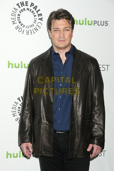 "Nathan Fillion.PaleyFest 2012 Presents ""Castle"" held at The Saban Theatre, Beverly Hills, California, USA, 9th March 2012..half length jacket blue shirt black leather .CAP/ADM/BP.©Byron Purvis/AdMedia/Capital Pictures."