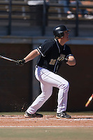 Third baseman Allan Dykstra (10) of the Wake Forest Demon Deacons follows through on his swing versus the Clemson Tigers during the first game of a double header at Gene Hooks Stadium in Winston-Salem, NC, Sunday, March 9, 2008.