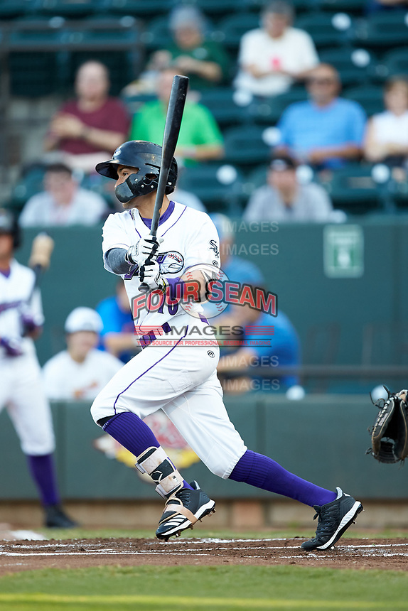 Laz Rivera (16) of the Winston-Salem Dash follows through on his swing against the Frederick Keys at BB&T Ballpark on July 26, 2018 in Winston-Salem, North Carolina. The Keys defeated the Dash 6-1. (Brian Westerholt/Four Seam Images)